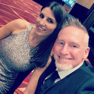Alicia Linklater smiling with hubsand Mike Penny at the rotary fire & ice gala - 2020