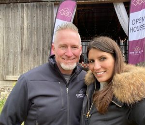 Alicia Linklater and Mike Penny smiling in photo at North Link Real Estate Team launch