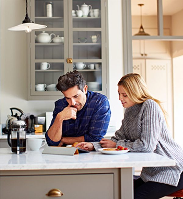 photo of couple doing real estate research