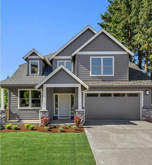 photo of a beautiful grey coloured home with garage