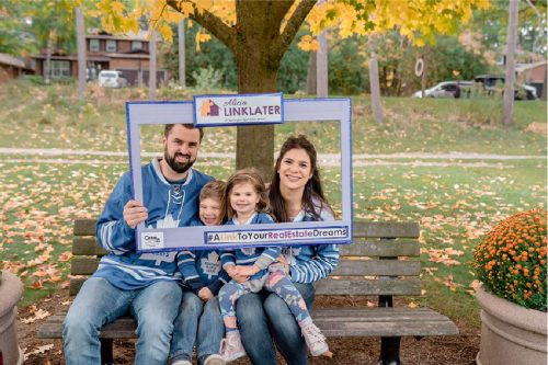 client appreciation photo of couple with their two kids