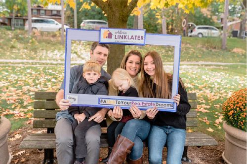 client appreciation photo of couple with their three kids