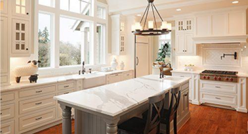 photo of beautiful white kitchen with hardwood flooring