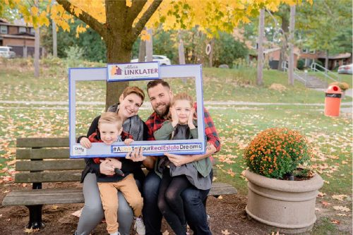 client appreciation photo with couple and their two kids