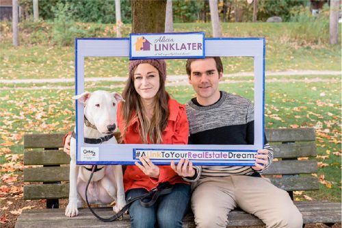 client appreciation photo with couple and their dog